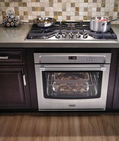For a seamless countertop look, a Maytag gas cooktop with Duraguard™ is up to the task. Makes for easier cleaning and seriously powerful cooking.