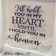 Beautifully decorated memorial picture frame in rememberance of loved ones no longer with us. Ill hold you in my heart until I hold you in heaven With a white glittered background and choice of white, pink or blue feathers. I also take custom requests for different coloured