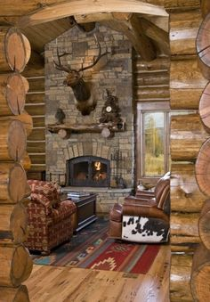 It just came to me ... all I need is a log cabin and a stone fireplace ... now I know what to do with all the antlers at my house!