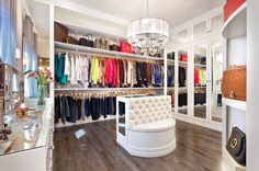 This bedroom was transformed into a glamorous closet. Custom built white cabinets. Dressing Room, glam closet, white closet, white cabinets, custom cabinets, walk in closet  More info at www.withinstudio.com