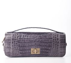 #Crocodile Baguette #clutch.  Handmade in Colombia.  Slick and understated. This minimalistic esthetic is the picture of lady like dressing. $900