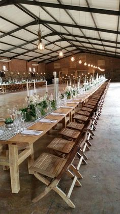 Reclaimed wooden tables and chairs by GRAND ROOM DESIGN