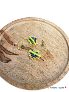 Arrow micro macrame hoops earrings. Neon yellow yarn and miyuki delica seed beads. © Natacha Fayard
