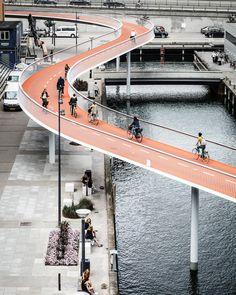 The Bicycle Snake. Bicycle Bridge, Copenhagen, Denmark. Competition: 2010, 1st prize, Completed 2014. Length: 230 m, Width: 4.6 m, Height difference between Havneholmen and Fisketorvet's main entrance: 5.5 m, Column distance: 17 m. Client: The City of Copenhagen. Architect: DISSING+WEITLING architecture. Landscape: Marianne Levinsen Landskab. Engineer: Rambøll (DK). Contractor: MT Højgaard (DK). Light Design: lightconstructor (DK). Photo: Rasmus Hjortshøj - COAST Studio.