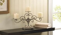 Decorate your home with a little French flair and a whole lot of candlelight with this beautiful stand. The scrolling metal curls are embellished with a stylize