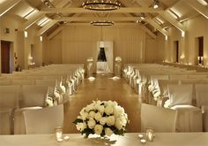 Stoke Place is protected by a gorgeous ancient wall which runs the length of the whole 26 acres of ground, and has a ceremony room that no couple could turn down. The white theme leaves plenty of room for décor, or on its own, makes a lovely simple ceremony room with lots of glamour.