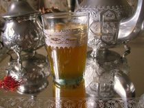Moroccan Tea with Saffron>>The thought of adding expensive saffron threads to a pot of steeping tea is likely to make frugal cooks shudder. Nonetheless, this fragrant tea is indeed enjoyed by some Moroccans, particularly near the small town of Taliouine, the saffron capital in Morocco,  located between Agadir and Ouarzazate in central Morocco.