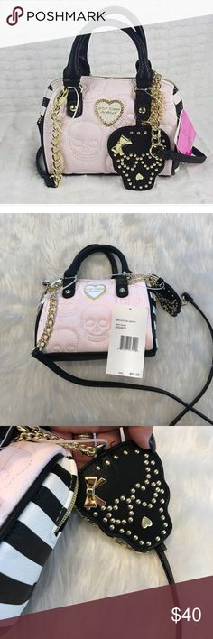 Betsy Johnson mini satchel bag BETSEY JOHNSON WOMEN QUILTED  SKULL MINI SATCHEL CROSSBODY BAG.  TOP ZIPPER CLOSURE. COLD HARDWARE. REMOVABLE STRAP. SKULL QUILTED DESIGN. SKULL FACE MIRROR CHARM. Long strap is removable Betsey Johnson Bags Crossbody Bags