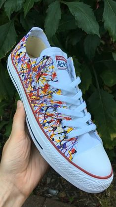 The finished pair of paint Splatter Low Top Converse in Navy, Yellow, Red and Purple finished with silver Swarovski crys Diy Converse, Painted Converse, Painted Canvas Shoes, Custom Painted Shoes, Painted Sneakers, Painted Jeans, Hand Painted Shoes, Custom Shoes, Disney Painted Shoes