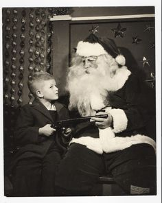 Christmas photos with Santa at the big department stores..My Dad played Santa ans was a mighty fine one...fooled me!