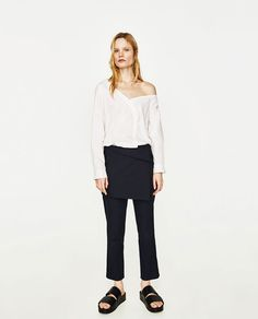 ZARA - WOMAN - POPLIN BODYSUIT $29.90 Bodysuit with asymmetric neckline. Long sleeves with buttoned cuffs. Buttoned front fastening. Press stud fastening on the bottom. COLOR: White 2114/046