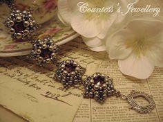 Asteria (smaller size), silver & grey bracelet beaded with glass beads, hematite and burgundy glass rivolis, handmade women's jewellery.