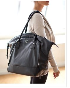 I have this bag in cream... it fits a lap top perfectly and tons of other stuff!!