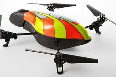 """Parrot's AR Drone is a four-propeller """"quadricopter"""" with a built-in front-view camera that streams what it captures onto your iPhone (via a free app). Pictured here with its """"hardshell""""! $299 for the naked drone!"""