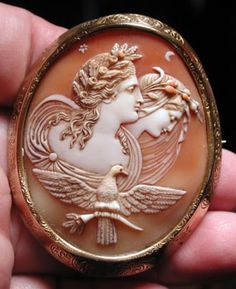 """Circa 1860 CARVED CAMEO OF NIGHT AND DAY. Nyx with poppies in her hair and Eos with flowers and the royal eagle. The large cameo is 2"""" by 2 1/2""""."""