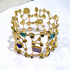 Petra Class Sapphire Tanzanite Aquamarine Amethyst Garnet Diamond Gold Bracelet | From a unique collection of vintage link bracelets at https://www.1stdibs.com/jewelry/bracelets/link-bracelets/