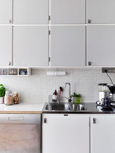 soft colours, soft light, polished hardware, back splash, stainless, white, pale grey/blue