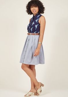 <p>Each day when you dress, you feel fortunate to wear this grey chambray skirt. The woven fabric is casual yet sharp, and the addition of the classic brown belt, button-up front, and flared pleats make this skirt a wardrobe staple. However you style it, you'll rock this day!</p>