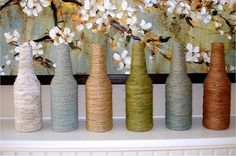 from buzzfeed 22 diy ways to reuse empty booze bottles have some empty