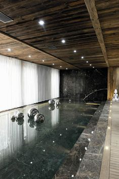 Indoor Pool at Chalet Brickell in Mègeve, France designed by Pure Concept