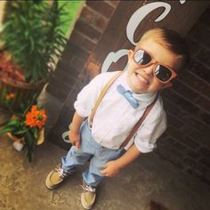 Dusty blue #bowtie and tan leather suspenders   A great look for #weddings, ring bearers, groom or groomsman, birthdays or cake smash photo.