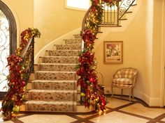 Christmas Interior traditional staircase - Staircase railing decorated with garlands, ribbons, bows, and christmas balls - At www.houzz.com #Christmas #Decorate #Staircase #Home  https://www.facebook.com/#!/DiMartinoChiropractic