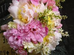So pretty for a late spring wedding. Pink peonies at their pink, along with the last of the in-season freesia. A fragrant bridal bouquet.