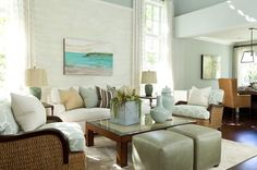 traditional living room Barclay Butera Living on the Coast by using soft, washy, beachy colors of paint like Ralph Lauren's Shoreline Blue, Faded Seafoam and Whisper (with all high-gloss white painted trims) you get a real, clean beach-glass feel.