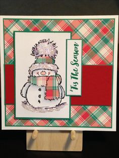 Christmas Card - Stamps:  Penny Black Snowy, Stampin' Up Christmas Pines - Inks:  Stampin' Up Emerald Envy, Memento Tuxedo Black - Copics:  C1, C2, C00, R20 - Ranger Ice Stickles Crystal Ice - Cardstock:  Lawn Fawn Perfectly Plaid Christmas, Stampin' Up Real Red, Stampin' Up Emerald Envy, Neenah Classic Crest Cover Solar White 80lb and 110lb