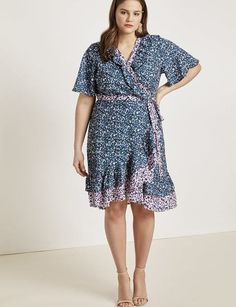 06dc1a38e2 View our Contrast Ruffle Wrap Dress and shop our selection of designer  women s plus size Dresses