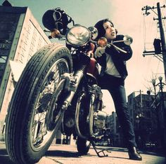 That vintage feeling. Woman + motorcycle.