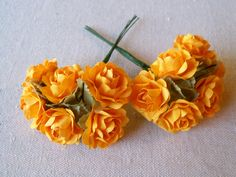 12 Goldenrod Paper Roses On Green Wire Stems, flowers measure about 1 1/4 inches. $6.50, via Etsy.
