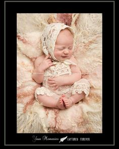 Newborn girl in vintage lace rompers and bonnet