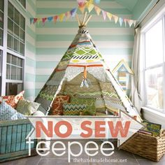 Handmade no sew Tee Pee - with the right fabrics and throw pillows, this fits perfectly in a designer adult space, too.