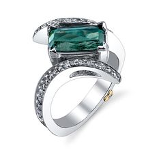 Brides.com: Green Engagement Rings. Style 18995, Graceful ring with tourmaline in 18k white gold accented with 0.57ctw of white diamonds, $6,081, Mark Schneider DesignSee more emerald-cut engagement rings.