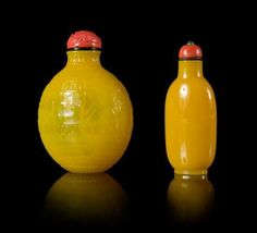Two Yellow Peking Glass Snuff Bottles Height of larger 3 1/4 inches. - Price Estimate: $500 - $700