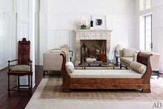 Paint it white. Carter conceived the sofas, the cocktail table is attributed to Jansen, and a Renaissance Revival armchair stands alongside an antique French daybed; the paneling is painted in a white from Carter's line for Benjamin Moore.