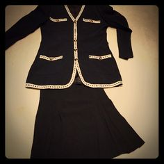 Vintage Chanel Style Suit. Vintage Chanel Styled Suit. Suit has a longer jacket with Ivory braided trim. Skirt is short & has several pleats in the front. 70's Vintage. Suit is by Nina K. Jacket is a size 10 & Skirt a size 8. Nina K Dresses