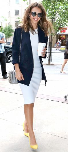 Jessica Alba understands the importance of having a statement piece in your outfit.  The multitasker extraordinaire recently stepped out in a neutral dress, blazer, and bag with bright yellow shoes