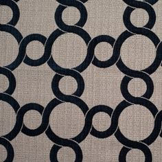 Flocked, velvety, indigo blue circles loop across the span of this upholstery fabric consisting of creped, tan and ivory, woven polyester yarns forming what looks like an uneven basket weave. Medium weight, this material would be great for upholstery and heavier drapery.