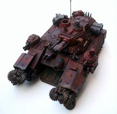 Because the only thing scarier than SuperHeavy Tanks, is Adeptus Mechanicus Super Heavy Tanks. With Chainsaws!