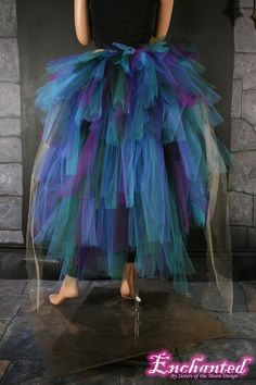 A beautiful bustle to add an extra wow to any costume! Add these to any tutu for extra volume! Perfect for Burlesque dancers and Halloween! Made from 6 layers and 180yards of soft smooth Bridal tulle in strips of purple, teal, turquoise, dark green, black, royal blue and streamers