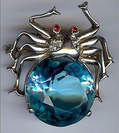 REJA VINTAGE GOLD WASH STERLING SILVER RHINESTONE FACETED BLUE GLASS SPIDER PIN: