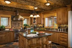 Love this kitchen! Log home with huge stove and open concept