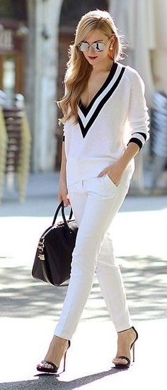 With A Black And White V-Neck Sweater, White Pants Black Bag And Sandals | Oh My Vogue                                                                             Source