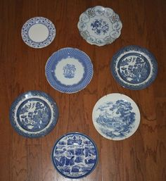 a unique vintage BLUE AND WHITE plates that need a loving home.