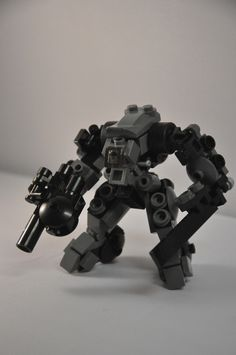 Mechs built from Legos For the game; Mobile Frame Zero.  XF-13b Grand Naga: Designed by: Mitten Ninja.     Bare Naga Frame Reference here: http://www.flickr.com/photos/mittenninja/7055442255/in/photostream  XF-13b Grand Naga    A Naga variant designed for close-quarters urban combat.    MFZ Stats:  High Capacity Tactical Shotgun 2d6Rd  Molecular Blade 2d6Rh  Armor Plating 1d6B  Wheels 1d6G