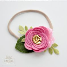 Gingerpop on Etsy - This is the perfect headband for your little one! A delicate dusty rose with a metallic gold center and green leaves.