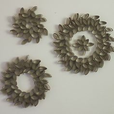 Wreaths constructed from toilet paper rolls.