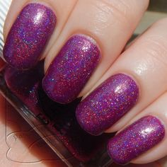 Elevation Polish SBP July 2014 - Name: Luoxia Valley Description: Fuchsia holographic with small multi-color holographic glitters. This polish will need top coat to smooth it out.